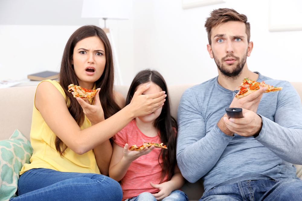 family-watching-tv-covered-eyes